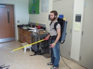 Jacob wearing the electrofishing equipment